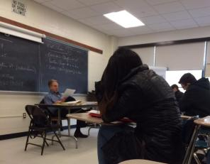 Professor Colletti teaching his students in class.