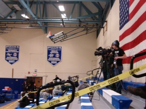A member of Sharks TV filming a game for the NJCAA