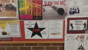 Along with other campus events, a CAB poster located in the Babylon Student Center  persuades students on campus to join their organization and provides their contact information.
